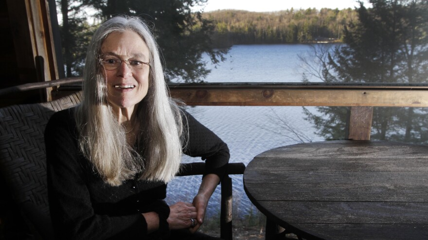 Sharon Olds'  poses on the porch of her home in Pittsfield, N.H., on Monday, when it was announced that her poetry collection titled <em>Stag's Leap</em> had won a Pulitzer.