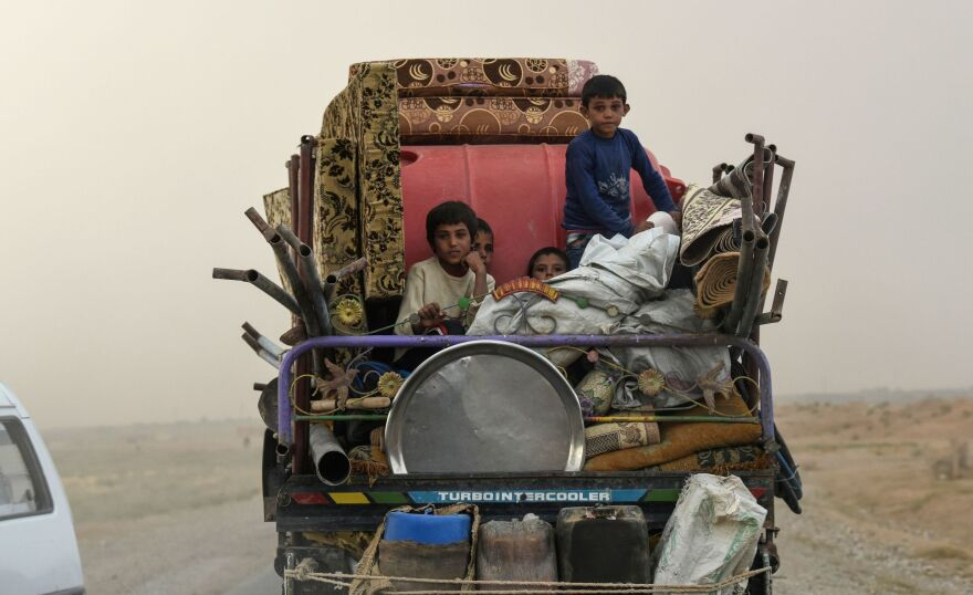 Displaced Syrians head to refugee camps on the outskirts of Raqqa on Sunday. Syrian fighters, backed by the U.S., have been driving out the Islamic State. However, many civilians are fleeing the fighting, and there's still no sign of a political settlement in Syria on the horizon.