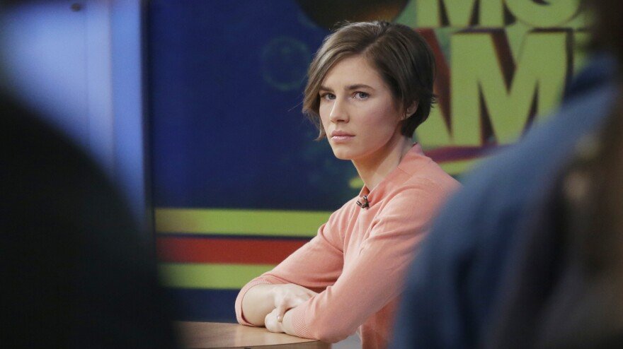 """Amanda Knox waits on the set of ABC's <em>Good Morning America</em> on Friday in New York. Knox said she will fight the reinstated guilty verdict against her and an ex-boyfriend in the 2007 slaying of a British roommate in Italy and vowed to """"never go willingly"""" to face her fate in that country's judicial system."""
