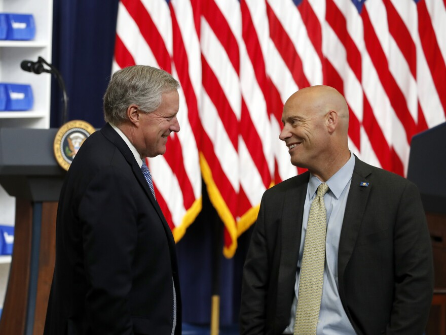 Vice President Mike Pence's chief of staff Marc Short, right, talks with White House chief of staff Mark Meadows before an event in July. Short is the latest White House aide to get the coronavirus.