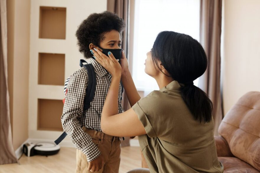 mother-putting-a-face-mask-on-her-son-4261266-1000x667.jpg
