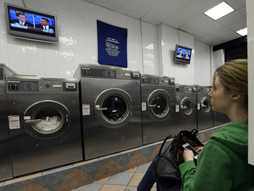 Watch the wash or watch the debate? This woman was at a laundromat in Manhattan during Monday's debate.