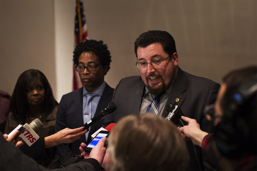 Ferguson Mayor James Knowles III answers question from reporters following Tuesday's city council meeting.
