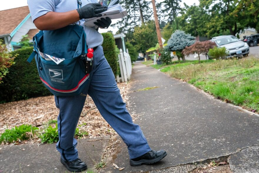 Letter Carrier Connie Cruz delivers mail in Salem, Oregon.