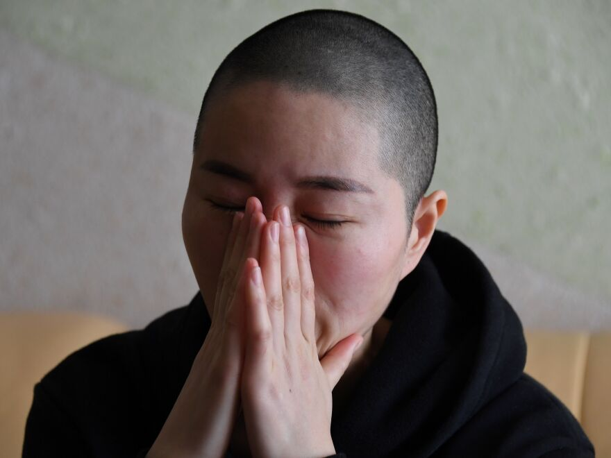 Li Wenzu, the wife of imprisoned lawyer Wang Quanzhang, reacts before an interview at her home in Beijing. Wang, a prominent Chinese human rights lawyer, was sentenced on Jan. 28 to 4 1/2 years in prison for state subversion.