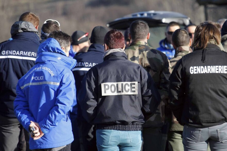Mountain troops, police and gendarme officers listen during a briefing before heading to the Germanwings crash site Thursday in Seyne-les-Alpes, France. A French prosecutor said Thursday the plane's second black box has been recovered.