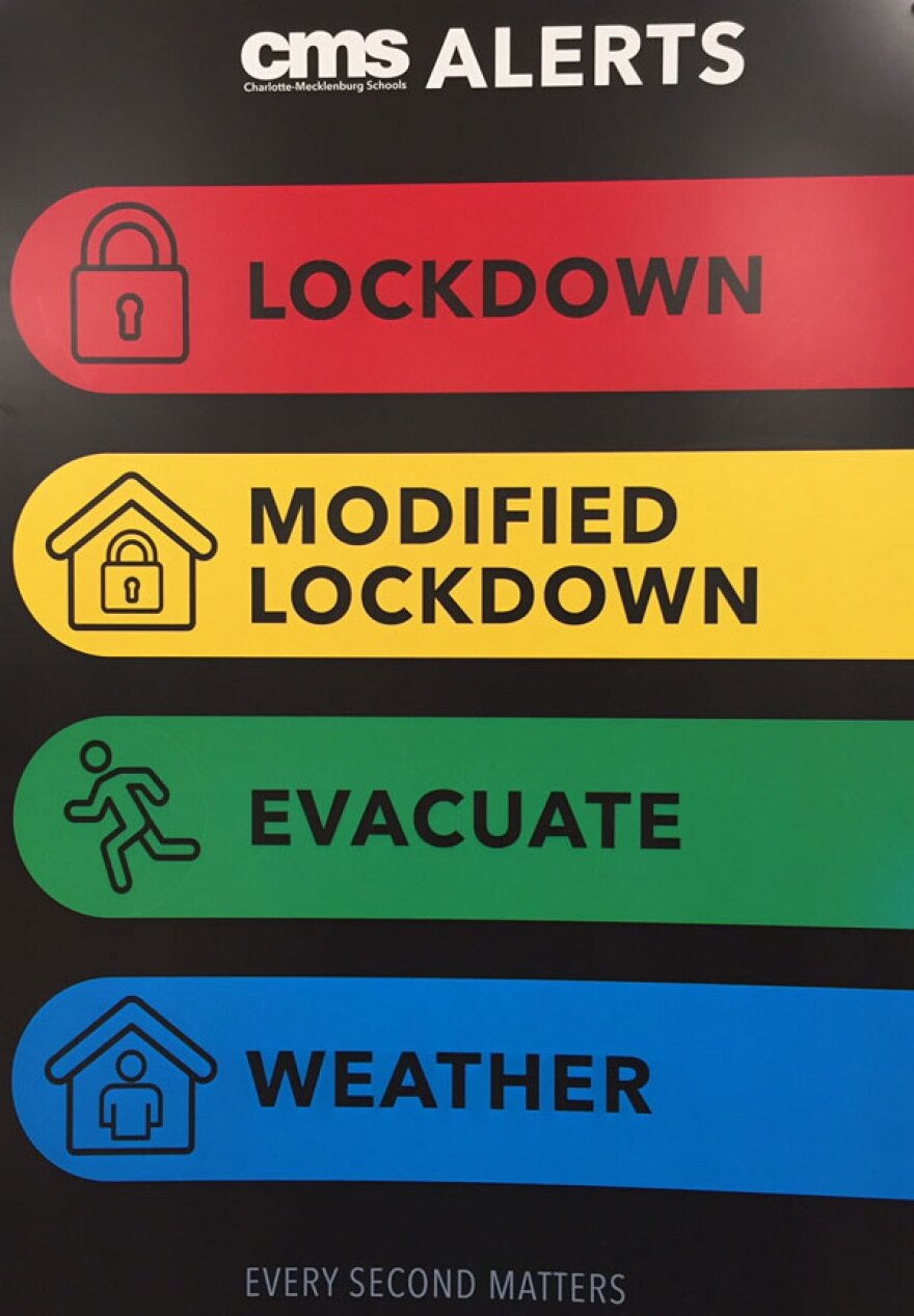 New panic alert cards being used in CMS high schools offer color-coded warnings for events that range from an active shooter to crime in a nearby neighborhood to bad weather.