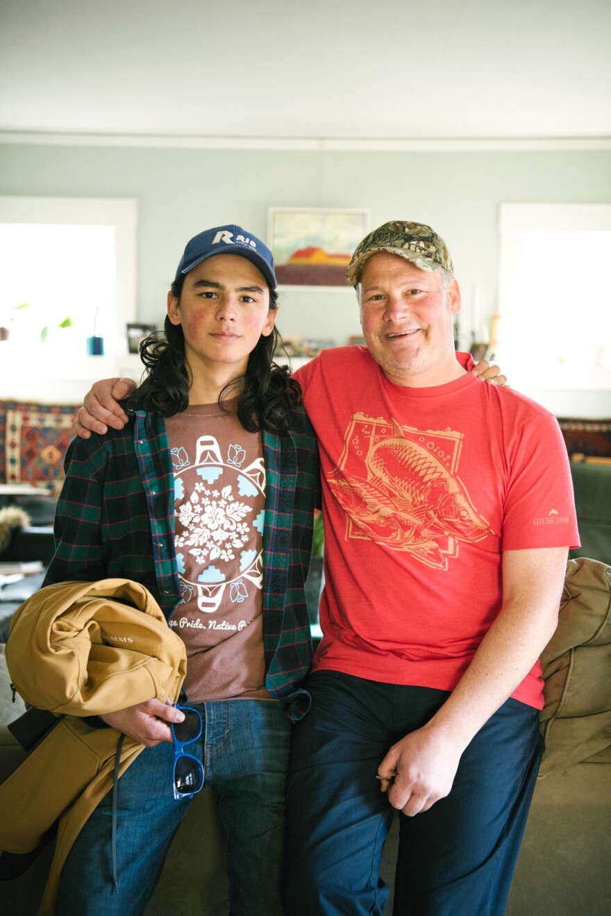 """Jeremy Schimmel, with his son Sam, says of Sam's childhood in Alaska: """"He never was inside. He hunted and fished."""""""