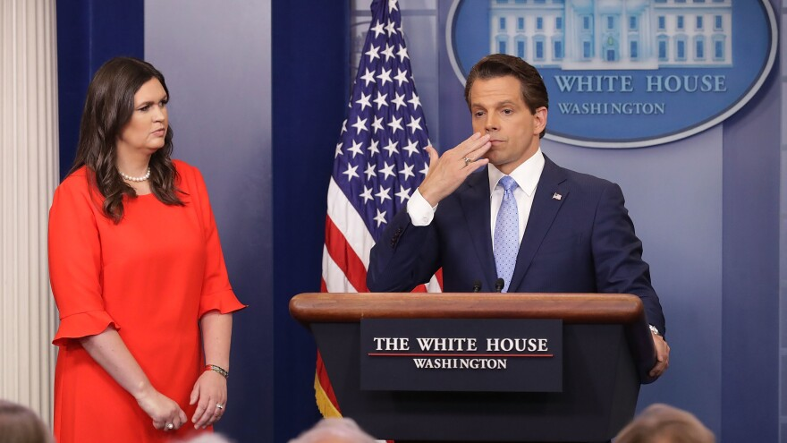 Anthony Scaramucci blows a kiss to the gathered press in the White House briefing room on July 21, as White House press secretary Sarah Huckabee Sanders stands by.