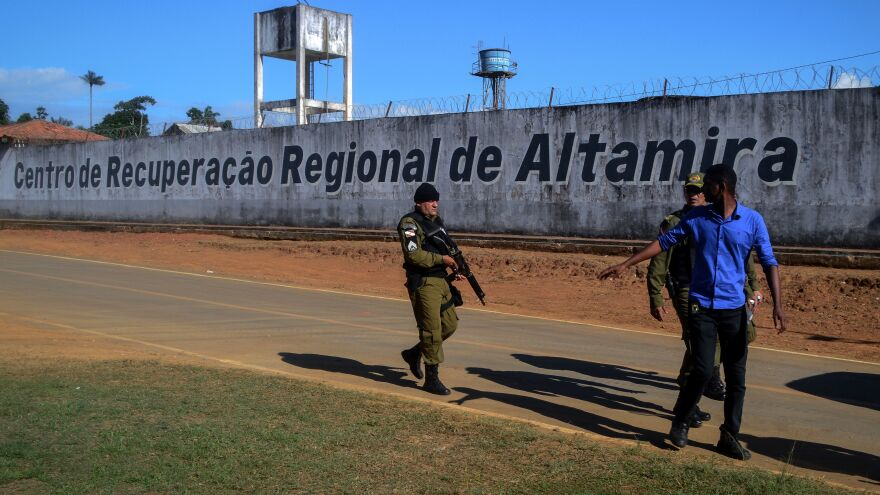 A police officer patrols the surroundings of the Altamira Regional Recovery Centre after at least 52 inmates were killed in a prison riot, in the Brazilian northern city of Altamira, Pará state, on Monday.