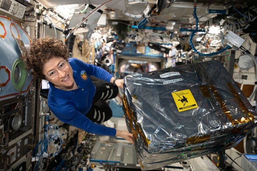 NASA astronaut and Expedition 61 Flight Engineer Christina Koch handles science hardware stowed inside a cargo transfer bag retrieved from the SpaceX Dragon resupply ship in December 2019.