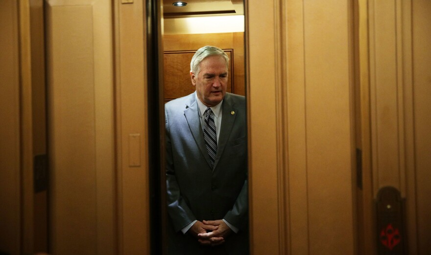Appointed Sen. Luther Strange, R-Ala., takes the elevator as he arrives at the Capitol for a vote.