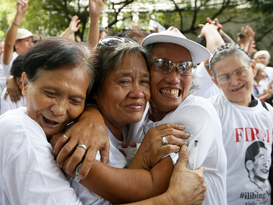 Supporters of late Philippine dictator Ferdinand Marcos shortly after the Philippine Supreme Court voted that Marcos can be buried at the country's Heroes' Cemetery.