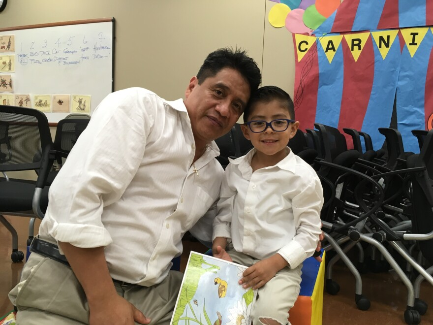 "Hector Peña and his 3-year-old son recently attended a ""Breakfast with Books and Dad"" literacy event at an early childhood center in Tulsa, Okla."