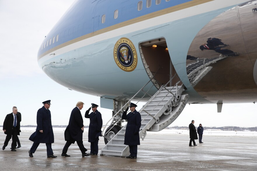 President Donald Trump boards Air Force One at Andrews Air Force Base, Md., en route to New Orleans.