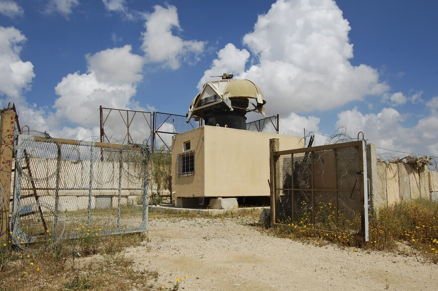 A camera and a machine gun are mounted on this Israeli watch post on the Gaza border, near the Nahal Oz area. Both are remote-controlled from a military observation room a couple of miles away.
