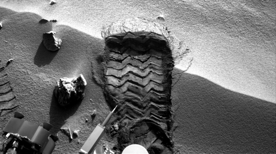 """NASA's Mars rover Curiosity cut a wheel scuff mark into a wind-formed ripple at the """"Rocknest"""" site to give researchers a better opportunity to examine the particle-size distribution of the material forming the ripple."""