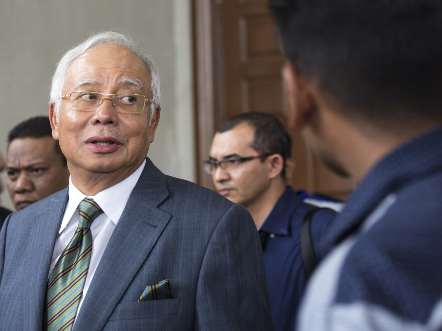 Malaysia's former Prime Minister Najib Razak exits the Kuala Lumpur High Court in August. He was charged of six counts of criminal breach of trust on Wednesday.