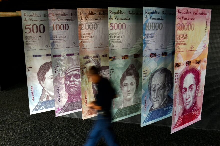 A banner depicting Venezuela's currency, the bolivar, at the central bank of Venezuela in Caracas in January. The bolivar has lost the vast majority of its value in just the last year.