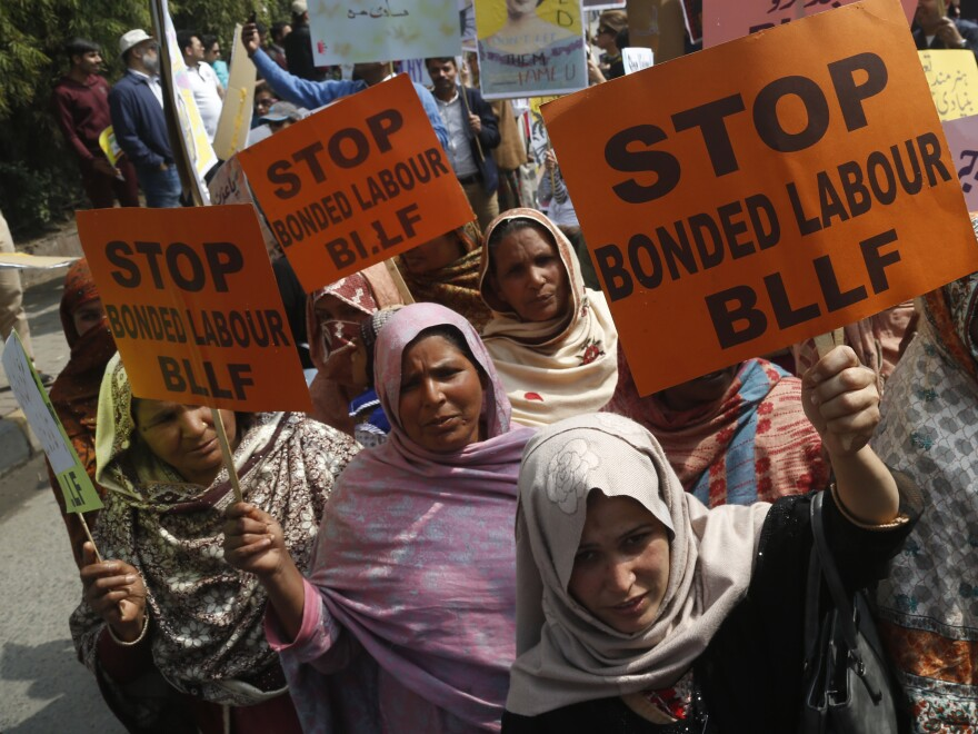 Pakistani activists take part in an International Women's Day rally in Lahore, Pakistan, Sunday. Pakistanis held rallies across the country, but were attacked in Islamabad.