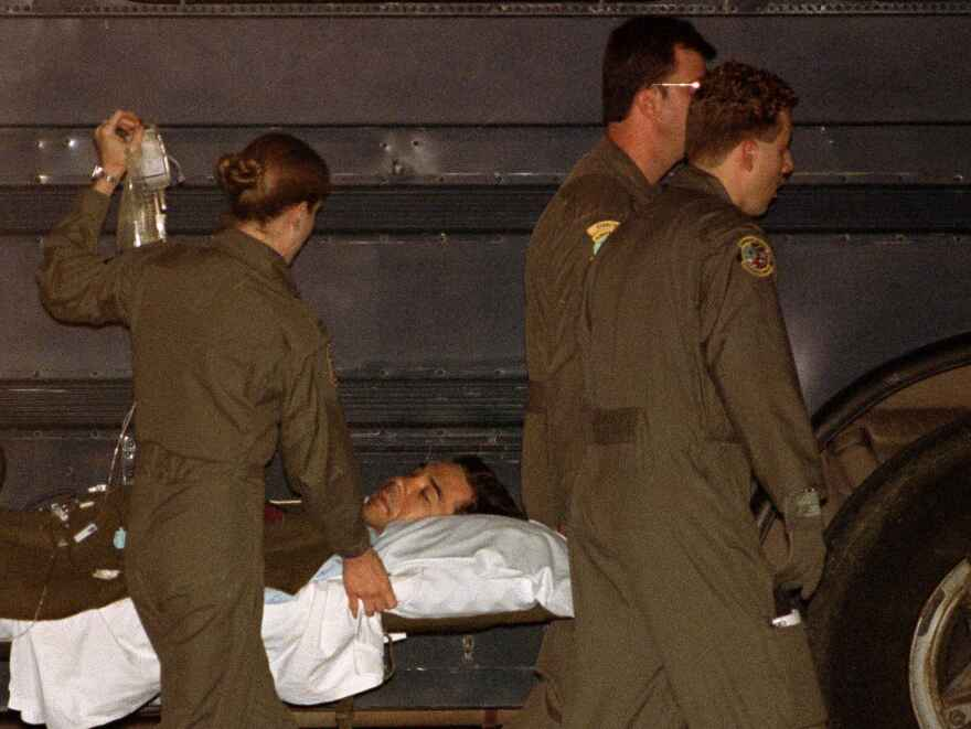 Chief Warrant Officer Michael Durant, wounded when the helicopter he was piloting was shot down in Somalia, arrives at Andrews Air Force Base in Maryland, on Oct. 16, 1993. He was held captive for 11 days.