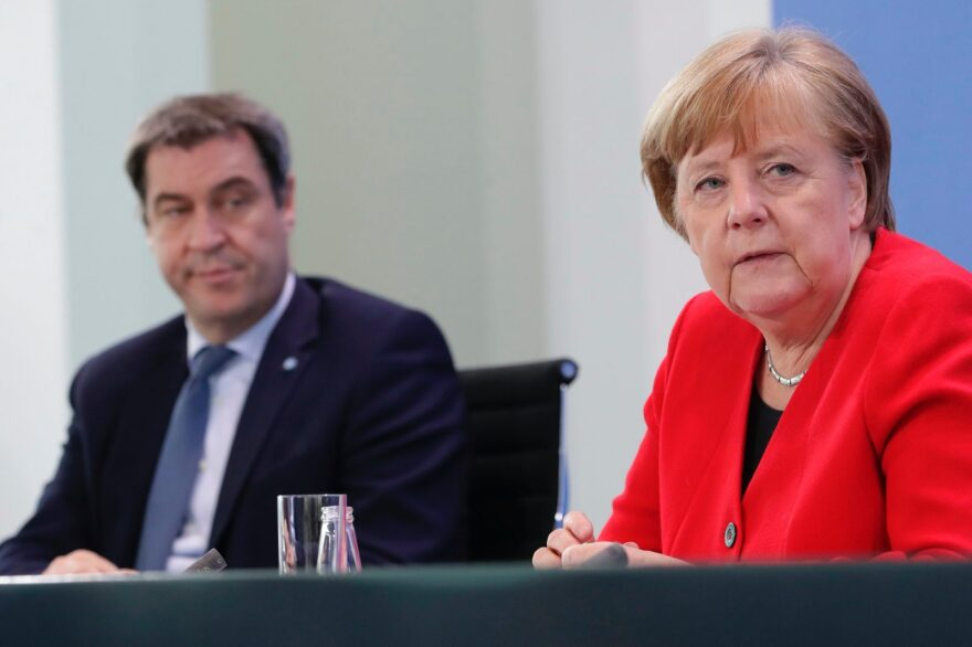 Markus Soeder, Bavaria's State Premier and German Chancellor Angela Merkel (R) attend a press conference at the Chancellery in Berlin on May 6, 2020 after holding a video conference with the leaders of the Federal states on easing the lockdown restrictions during the novel coronavirus COVID-19 pandemic.