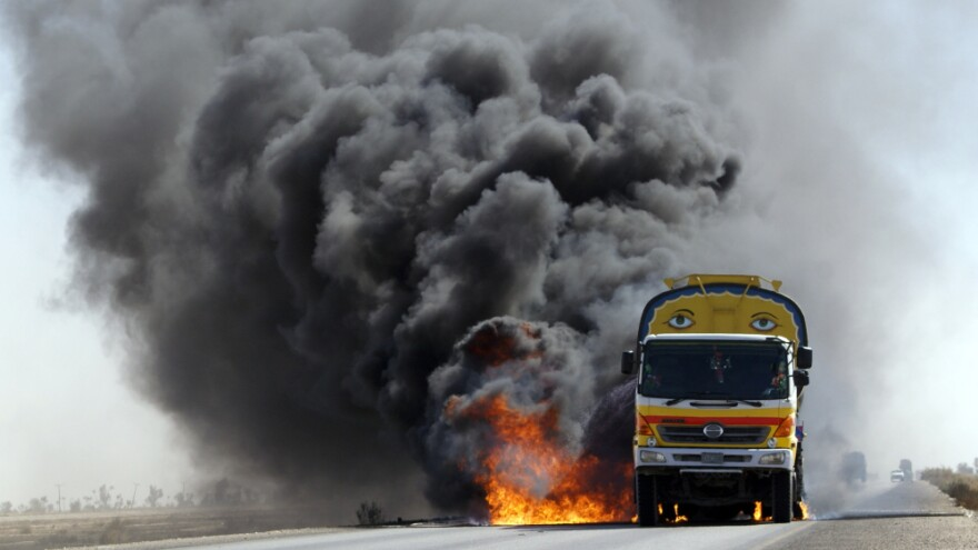 For the first seven years of the war in Afghanistan, almost all U.S. and NATO supplies were trucked overland to Afghanistan through parts of Pakistan effectively controlled by the Taliban. Here, smoke and flame rise from a burning NATO supplies oil tanker after armed militants torched the tankers  in Mithri, Pakistan, in February.