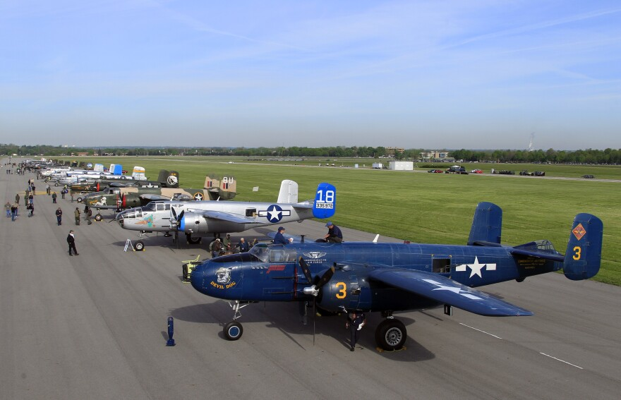 """Twenty B-25 """"Mitchell"""" bombers line up on a runway at Wright Patterson Air Force base in Dayton, Ohio, on April 17, 2012. The WWII era warplanes had flown in for the 70th anniversary of the 1942 Doolittle Tokyo Raid."""