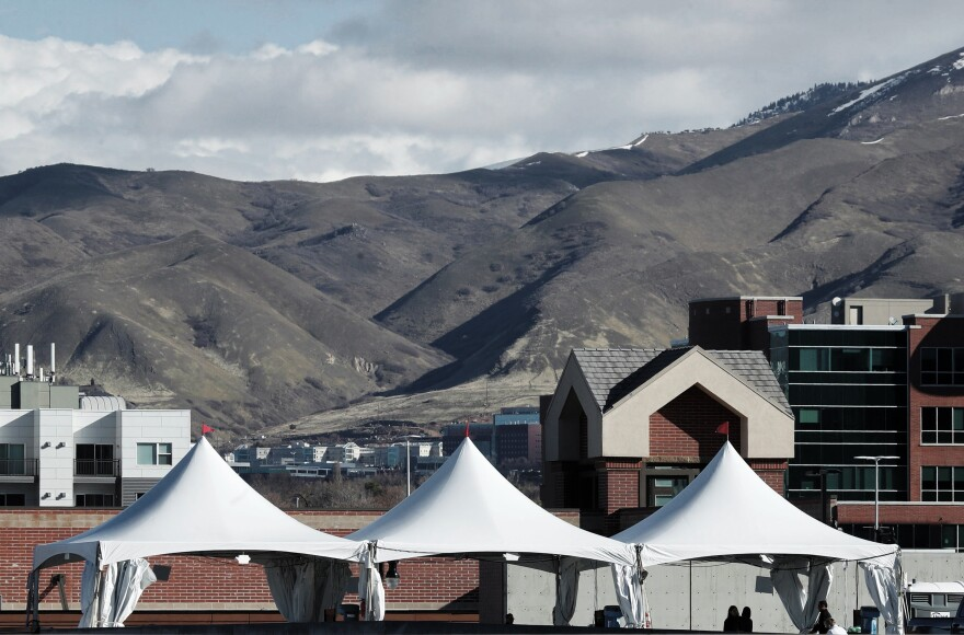 Three tents at one of the first drive-through testing facilities for COVID-19 in Salt Lake City, set up in mid-March at a parking lot outside a University of Utah health clinic.
