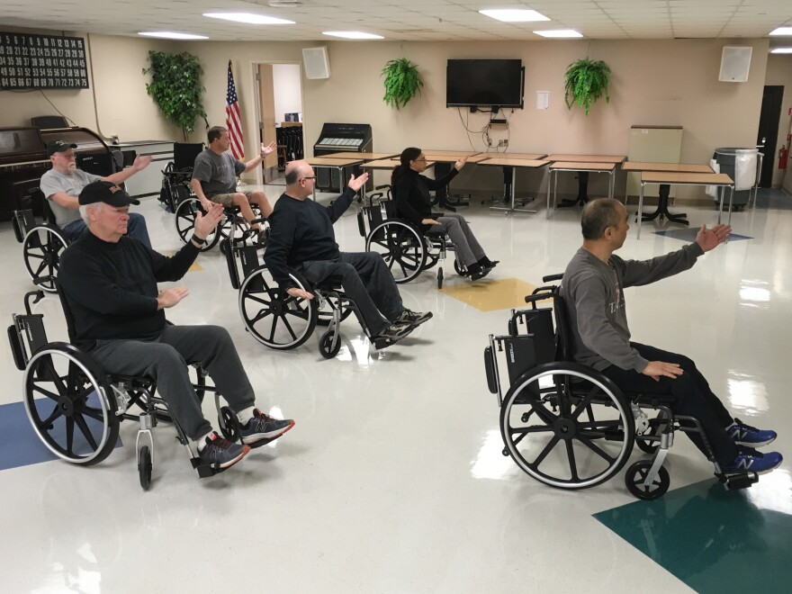 Veterans in Murfreesboro, Tenn., enjoy a wheelchair tai chi class; other alternative health programs now commonly offered at VA hospitals in the U.S. include yoga, mindfulness training and art therapy.