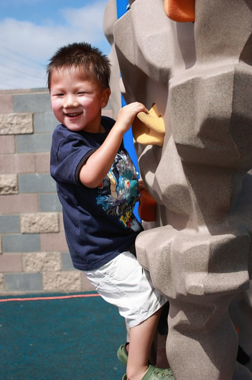 Alex, 5, climbs an obstacle in 2009.