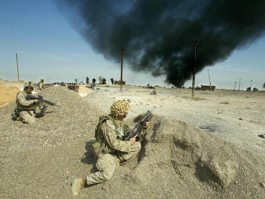 U.S. Marines deploy in the town of al-Nasr Wa al-Salam near Fallujah on March 28, 2004.