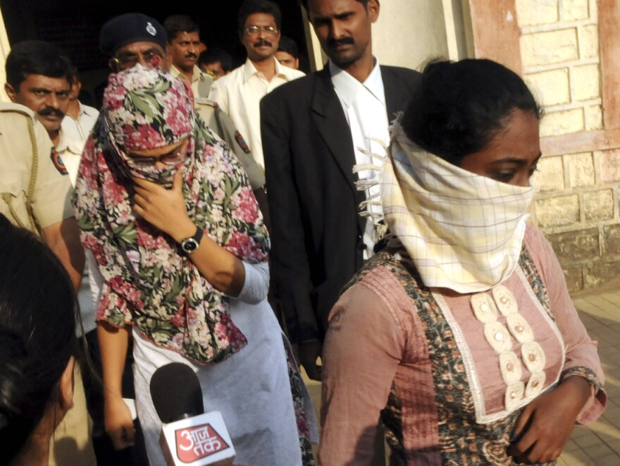 "Shaheen Dhada (left) and Renu Srinivasan leave court in Mumbai on Nov. 19. Dhada was arrested for a Facebook post questioning the shutdown of Mumbai for the funeral of a powerful politician; Srinivasan was arrested for ""liking"" the post."