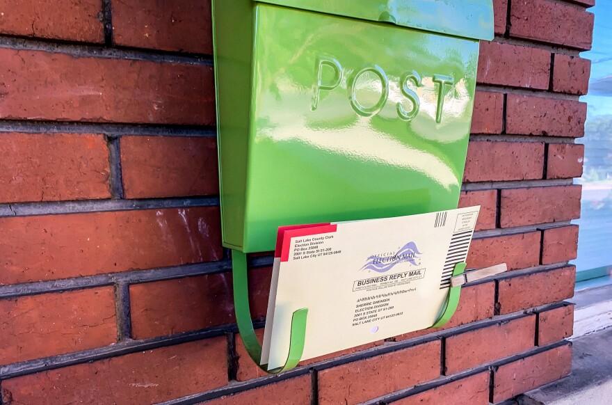 Photo of a ballot on a mailbox