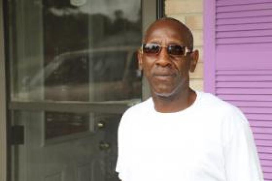 Willie Freeman, 54, in front of his parents' house in Little Rock.