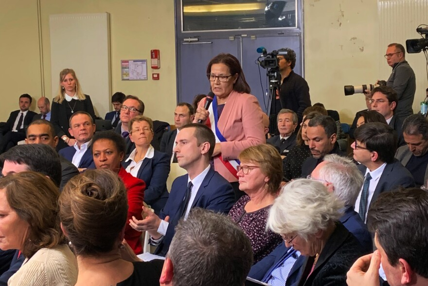 Meriem Derkaoui, the mayor of Aubervilliers, a suburb north of Paris, speaks at Monday's meeting with President Emmanuel Macron. During the meeting, she expressed frustration with delays in a Paris metro extension to her town.