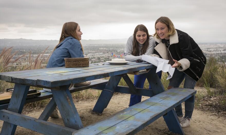 Actors Kaitlyn Dever, left, and Beanie Feldstein work with director Olivia Wilde on the set of <em>Booksmart.</em>