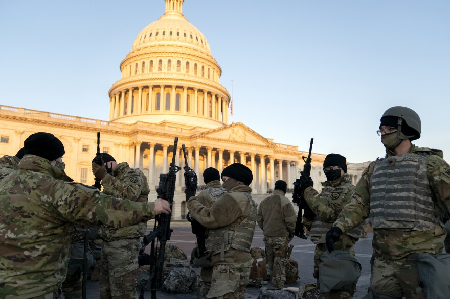 Weapons are distributed to members of the National Guard outside the U.S. Capitol on Wednesday. Security has been increased throughout Washington following the breach of the U.S. Capitol on Jan. 6, and leading up to the Presidential inauguration.