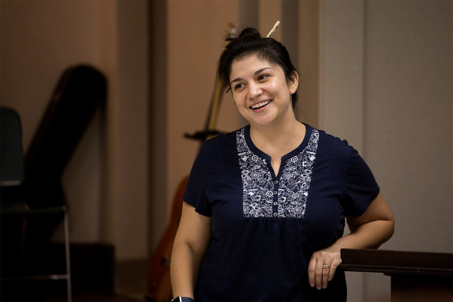 "Director Christina Rios jokes with the cast during a ""21 Chump Street"" rehearsal."
