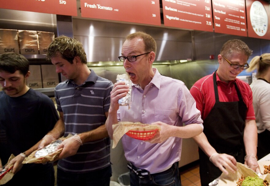 Steve Ells, center, CEO of Chipotle Mexican Grill, in 2008 in New York. Increasingly, CIA school graduates like Ells are charting new career paths that require more business chops.