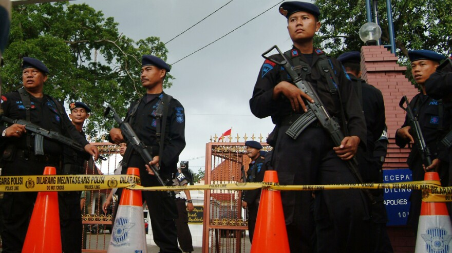Indonesian Mobile Brigade policemen stood guard outside a West Java police station housing a mosque that was hit by a suicide strike during Friday prayers.