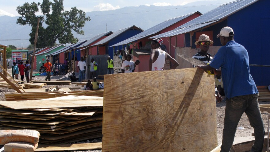 Last year, the Annex de Martissant area of Port-au-Prince was a camp for displaced people. The area was filled with tents. Today, locals are building sturdier shelters with funding from the American Red Cross.