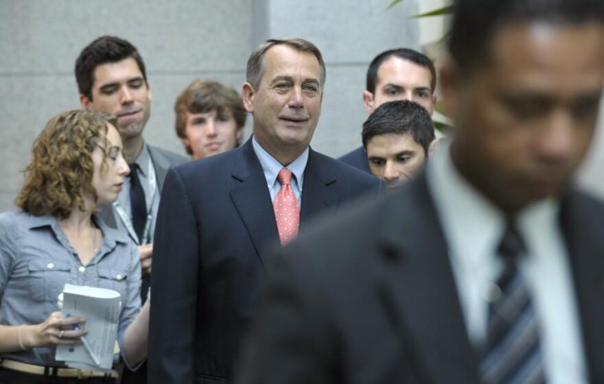 House Speaker John Boehner of Ohio walks to a caucus meeting on Capitol Hill in Washington.
