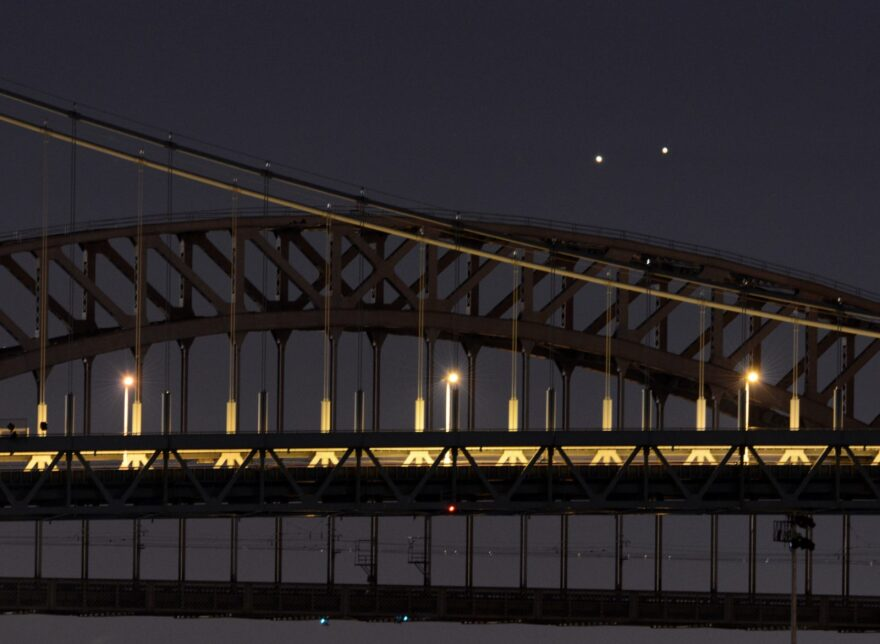 Venus (L) and Jupiter (R) rise together in a  rare conjunction over the Hell Gate (rear) and Robert F. Kennedy (front) Bridges in the early morning in New York.