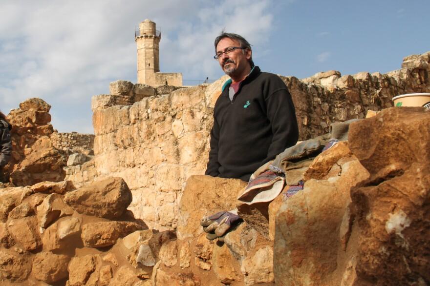 Benny Har-Even, the Israeli military's deputy archaeologist, stands among the ruins of a village dating to the 2nd century B.C.
