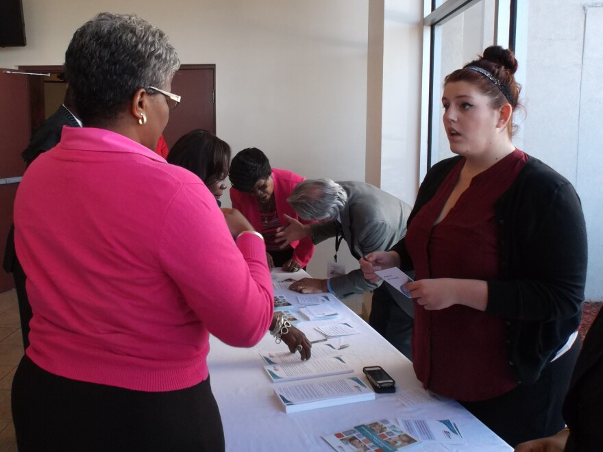 Enroll America outreach workers talk to congregants at the Mt. Calvary Church in Jacksonville, Fla.