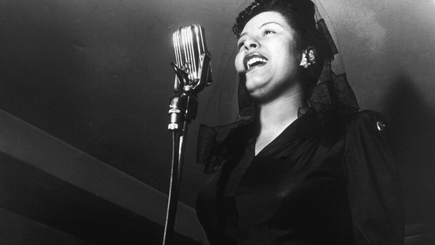 Billie Holiday sings at a Sunday afternoon jam session.