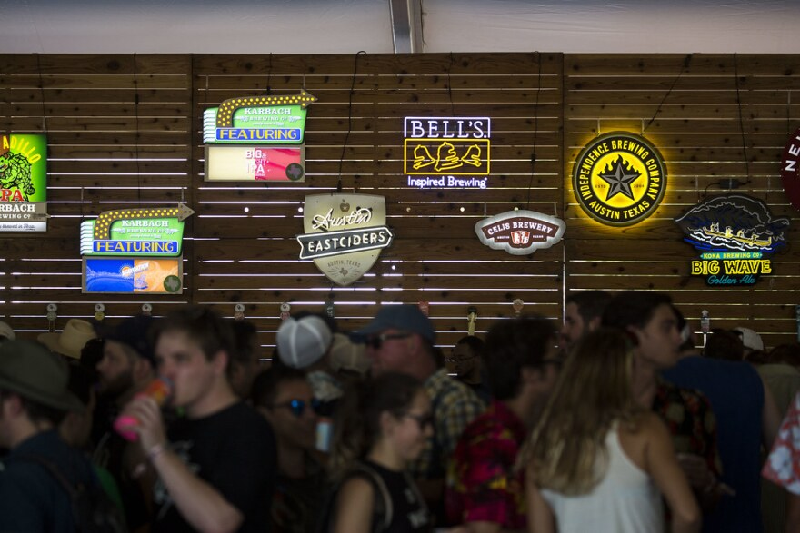 Folks drink at the Barton Springs Beer Hall.