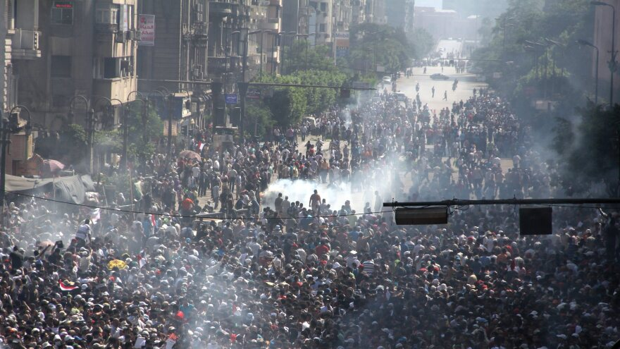 Muslim Brotherhood supporters clash with police near Ramses square. The army deployed dozens of armored vehicles on major roads in Cairo, and the Interior Ministry has said police will use live ammunition against anyone threatening state installations.