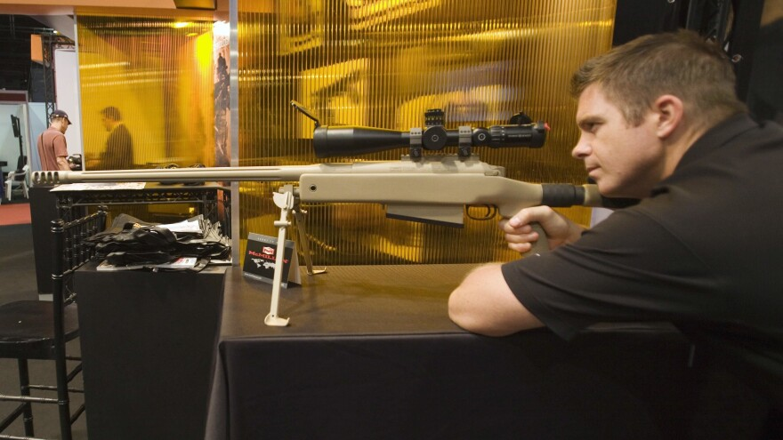 A McMillan TAC-50 sniper rifle, like the one pictured at a trade show in 2010, was used to make the record-breaking shot during an operation in Iraq.